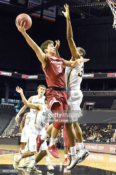 Dusty Hannahs of the Arkansas Razorbacks takes a shot during game on of the NIT Season TipOff college basketball tournament at Barclays Center...