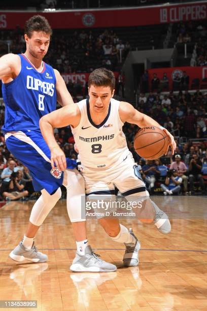 Dusty Hannahs of the Memphis Grizzlies drives past Danilo Gallinari of the LA Clippers on March 31 2019 at STAPLES Center in Los Angeles California...
