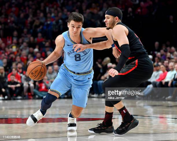 Dusty Hannahs of the Memphis Grizzlies drives past Seth Curry of the Portland Trail Blazers during the second half at the Moda Center on April 03...