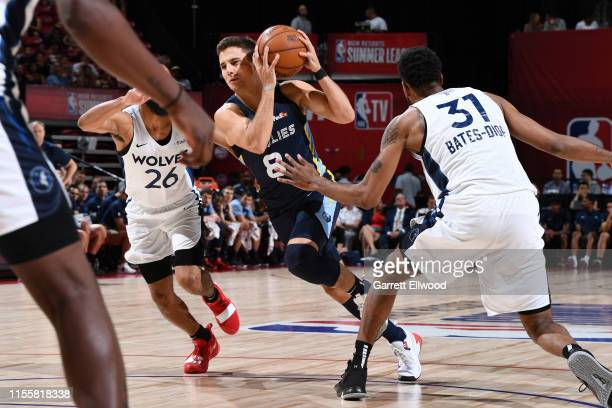 Dusty Hannahs of the Memphis Grizzlies drives to the basket against the Minnesota Timberwolves during the Finals of the Las Vegas Summer League on...