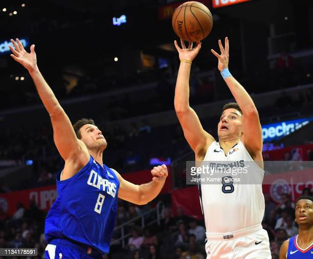 Dusty Hannahs of the Memphis Grizzlies gets by Danilo Gallinari of the Los Angeles Clippers for a basket in the second half of the game at Staples...
