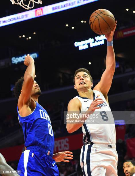 Dusty Hannahs of the Memphis Grizzlies gets by Jerome Robinson of the Los Angeles Clippers for a basket in the second half of the game at Staples...