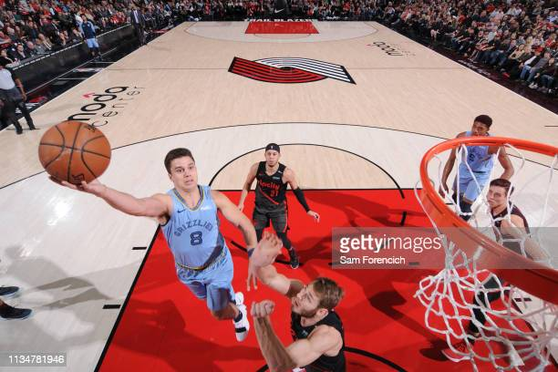 Dusty Hannahs of the Memphis Grizzlies goes to the basket against the Portland Trail Blazers on April 3 2019 at the Moda Center in Portland Oregon...