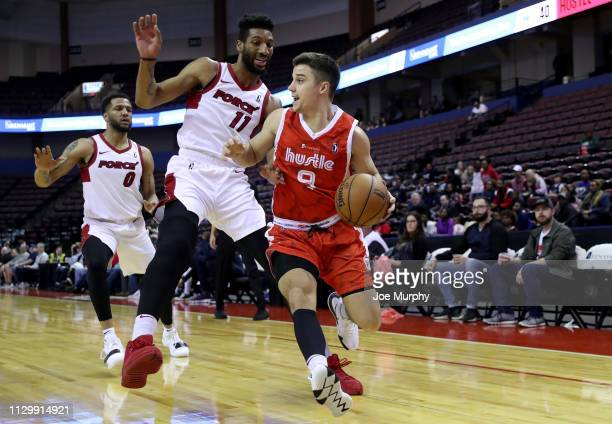 Dusty Hannahs of the Memphis Hustle dribbles the ball against Marcus Lee of the Sioux Falls Skyforce during an NBA GLeague game on March 11 2019 at...