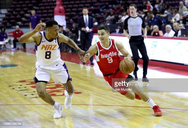 Dusty Hannahs of the Memphis Hustle drives against George King of the Northern Arizona Suns during an NBA GLeague game on February 8 2019 at Landers...