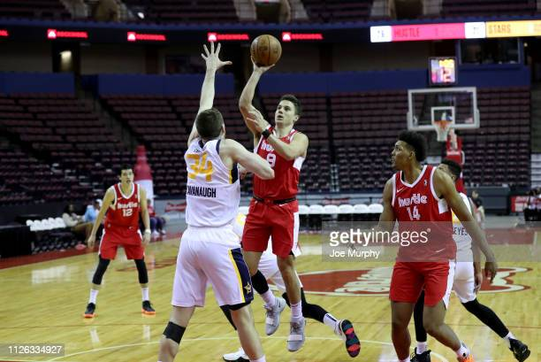Dusty Hannahs of the Memphis Hustle shoots against Tyler Cavanaugh of the Salt Lake City Stars during an NBA GLeague game on February 20 2019 at...