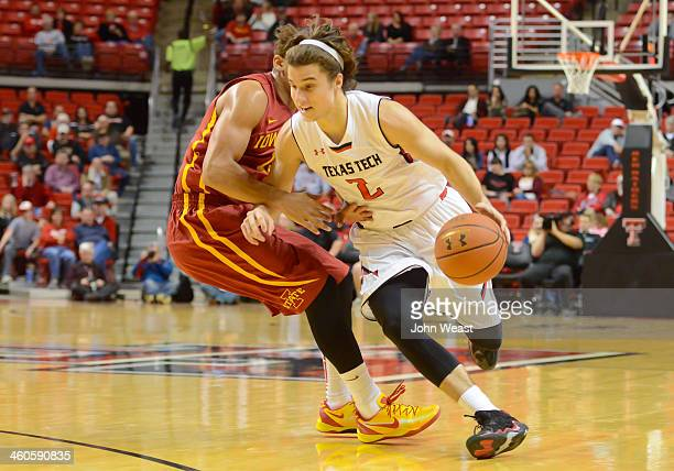 Dusty Hannahs of the Texas Tech Red Raiders dribbles by Naz Long of the Iowa State Cyclones during game action on January 4 2014 at United Spirit...
