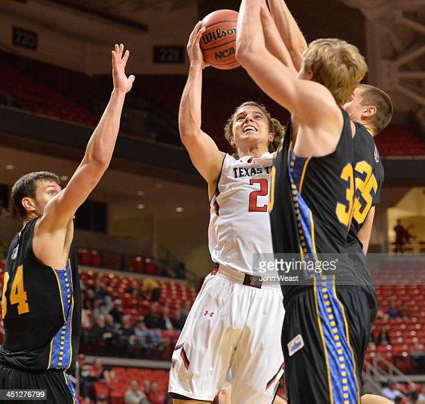 Dusty Hannahs of the Texas Tech Red Raiders drives to the basket during game action against the South Dakota State Jackrabbits on November 21 2013 at...