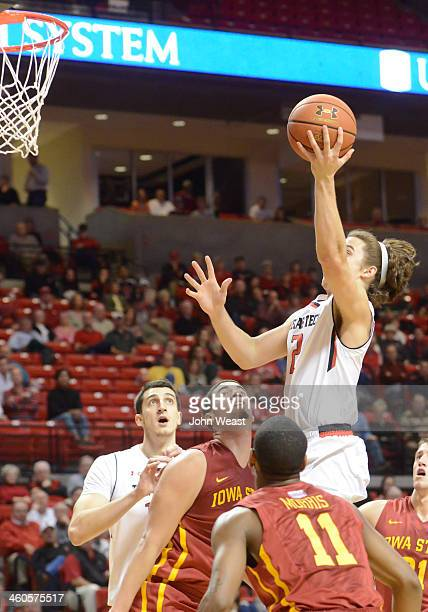 Dusty Hannahs of the Texas Tech Red Raiders drives to the basket during game action against the Iowa State Cyclones on January 4 2014 at United...