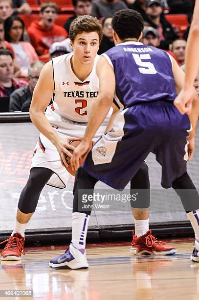 Dusty Hannahs of the Texas Tech Red Raiders is guarded by Kyan Anderson of the TCU Horned Frogs during game action on February 01 2014 at United...