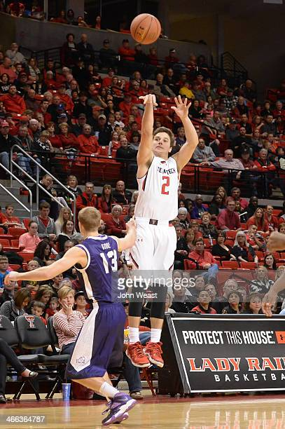 Dusty Hannahs of the Texas Tech Red Raiders shoots a 3 pointer over Christian Gore of the TCU Horned Frogsduring game action on February 01 2014 at...