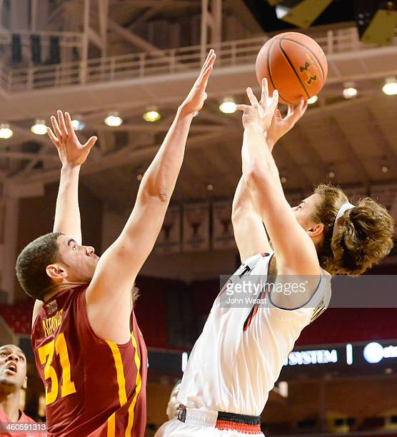 Dusty Hannahs of the Texas Tech Red Raiders shoots the ball over Georges Niang of the Iowa State Cyclones during game action on January 4 2014 at...