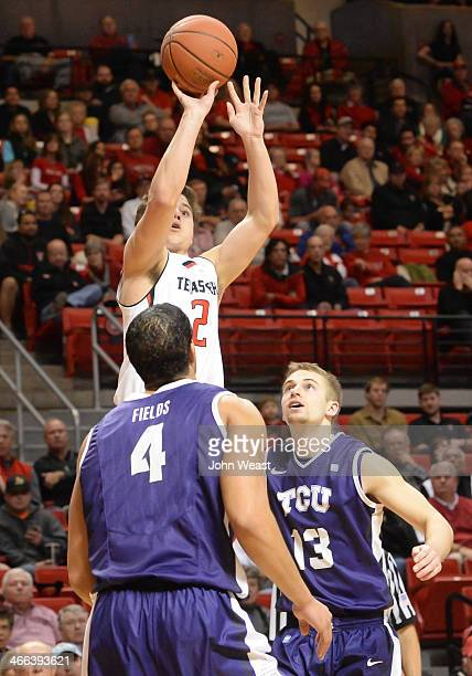 Dusty Hannahs of the Texas Tech Red Raiders shoots the ball over Amric Fields of the TCU Horned Frogs during game action on February 01 2014 at...