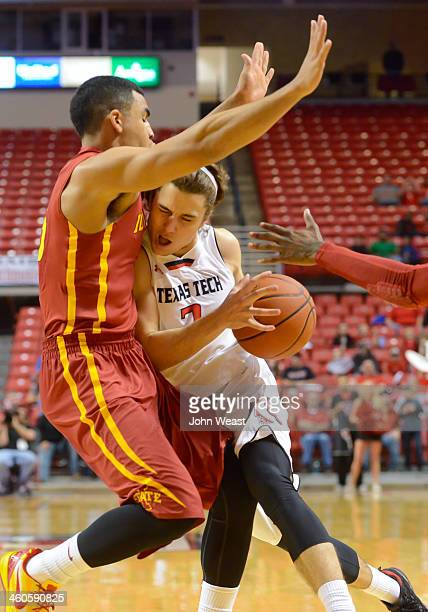 Dusty Hannahs of the Texas Tech Red Raiders tries to drive past Naz Long of the Iowa State Cyclones during game action on January 4 2014 at United...
