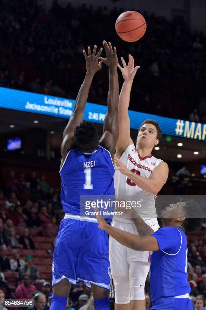 Dusty Hannahs of the University of Arkansas puts up a shot over Michael Nzei of Seton Hall University during the 2017 NCAA Photos via Getty Images...