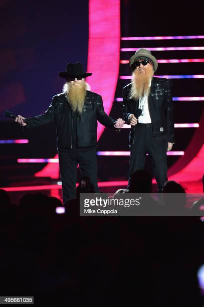 Dusty Hill and Billy Gibbons of ZZ Top perform onstage during the 2014 CMT Music awards at the Bridgestone Arena on June 4 2014 in Nashville Tennessee