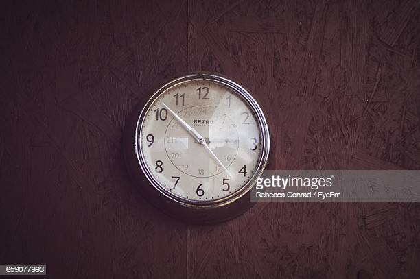 Dusty Old-Fashioned Clock Mounted On Wall