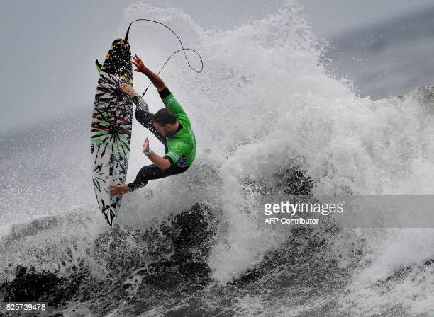 TOPSHOT Dusty Payne of Hawaii gets some air during his round two heat in the men's division at the US Open of Surfing in Huntington Beach California...