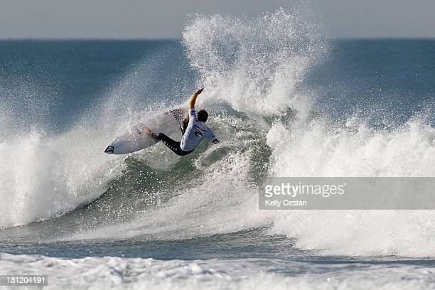 Dusty Payne of Hawaii surfs on his way to elimination from the RipCurl Pro Search after being defeated by Raoni Monteiro of Brazil in Round 2 at...