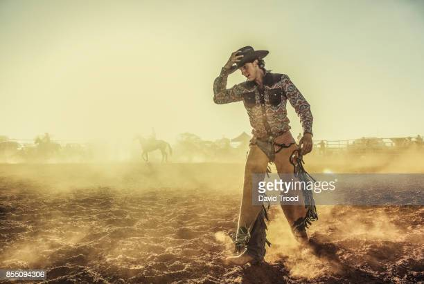 a dusty rodeo in central queensland, australia. - カウボーイ ストックフォトと画像