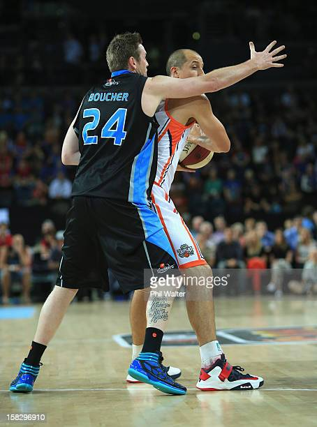 Dusty Rychart of the Taipans is put under pressure from Dillon Boucher of the Breakers during the round 11 NBL match between the New Zealand Breakers...