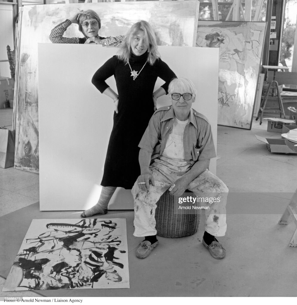 Dutch abstract painter Willem De Kooning poses for portrait in his studio with daughter Lisa and wife Elaine December 17, 1978 in Springs, New York.