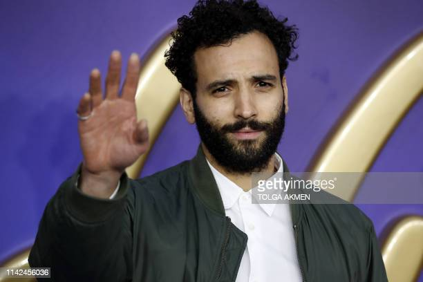 Dutch actor Marwan Kenzari poses on arrival for the European Gala of Aladdin in central London on May 9 2019