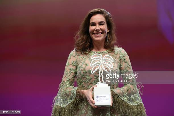 Dutch actress Halina Reijn poses with the Award for the Best Interpretation for the all casting of Red Light during the closing ceremony of the 3rd...