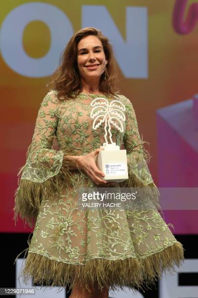 Dutch actress Halina Reijn poses with the Award for the Best Interpretation for the all casting of MRed Light during the closing ceremony of the 3rd...