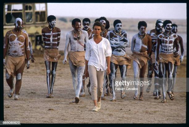 Dutch actress Maruschka Detmers strides through the Moroccan desert followed by a host of other actors in African tribal dress for the filming of...