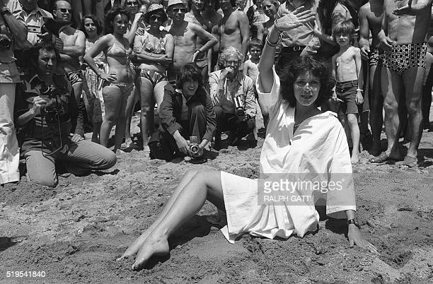 "Dutch actress, model and singer. Sylvia Kristel, poses as a ""starlet"" on the Carlton Hotel beach on May 13, 1977 in front of press photographers and..."