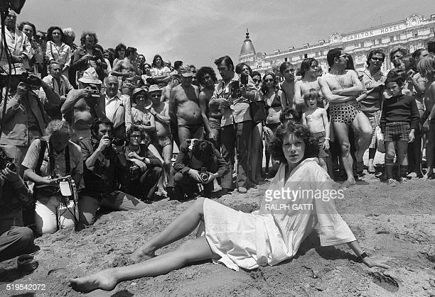Dutch actress model and singer Sylvia Kristel poses as 'starlet' on the Carlton Hotel beach on May 13 1977 in front of press photographers and fans...