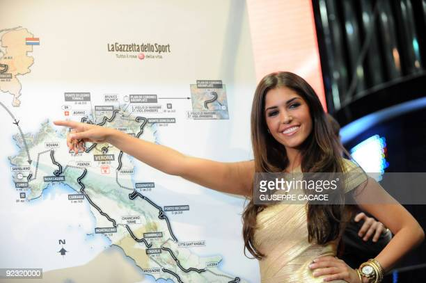 Dutch actress Yolanthe Cabau van Kasbergen poses near the map of the 93th edition of 'Giro d'Italia' during the presentation at East end studios in...