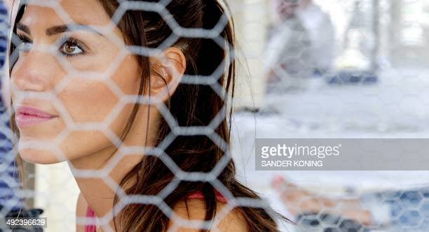 Dutch actress Yolanthe SneijderCabau wife of Dutch soccer player Wesley Sneijder is being locked up in a cage for the action 'Lock Me Up Free a Girl...