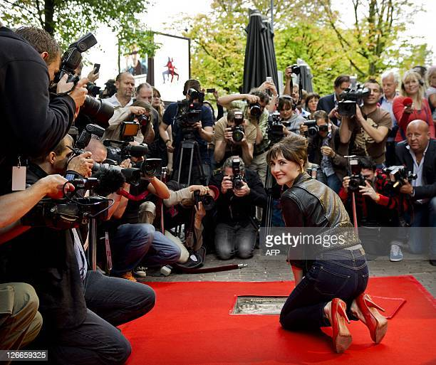 Dutch actrice Carice van Houten and actor Barry Atsma reveal their gold tiles in Utrecht The Netherlands on September 26 2011 Last year Carice won a...
