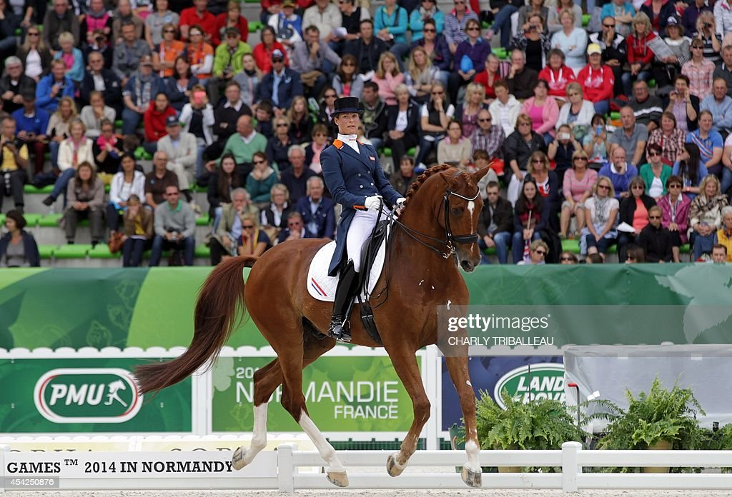 Dutch Adelinde Cornelissen rides Jerich Parzival N.O.P. on August 27, 2014 during the Individual Dressage Grand Prix of the 2014 FEI World Equestrian Games at D'Ornano Stadium in the northwestern French city of Caen.