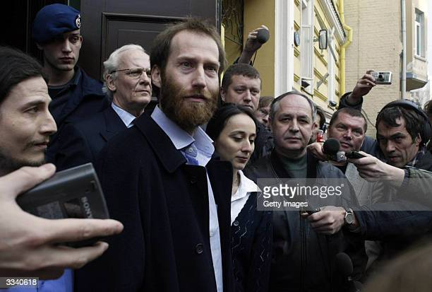 Dutch aid worker Arjan Erkel answers questions from the media on the steps of the Dutch embassy on April 11 2004 in Moscow Erkel who was kidnapped...