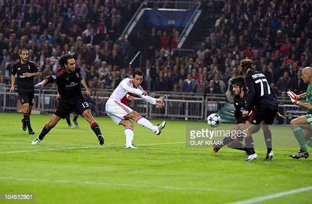 Dutch Ajax soccer player Mounir El Hamdaoui scores 10 for his team during the second round match in Group G of the UEFA Champions League in the...