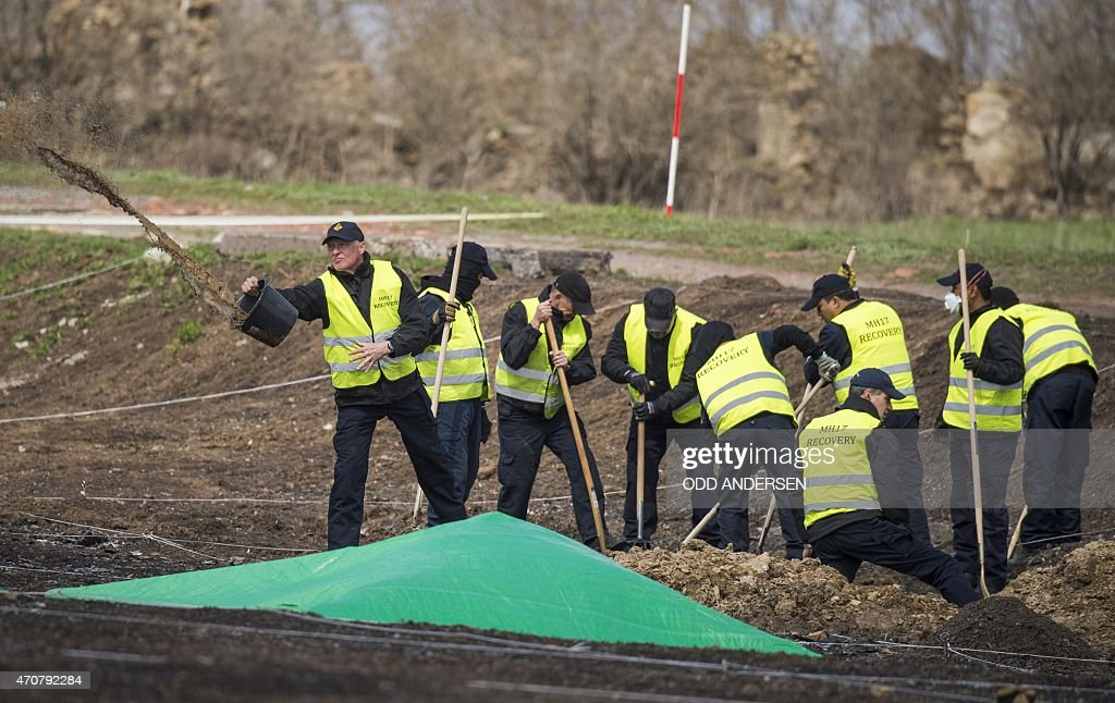 Dutch and Malaysian investigators and local authorities dig, on April 23, 2015 on the site where the bulk of the Malaysian Airlines flight MH17 was shot out of the sky near the village of Grabove in the self-proclaimed Donetsk People's Republic (DNR). Dutch investigators have recovered 'many' more body parts and pieces of wreckage after resuming their search at the MH17 plane crash site in Ukraine, the Netherlands said on the eve. All 298 passengers and crew onboard the Malaysia Airlines jetliner -- most of them Dutch -- died when it was shot down over rebel-held eastern Ukraine last year.