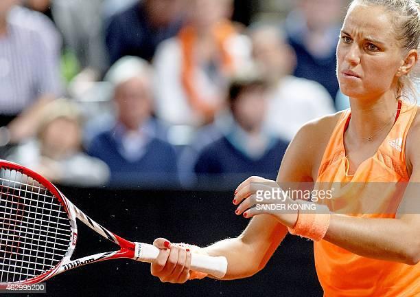Dutch Arantxa Rus returns the ball to Anna Schmiedlova of Slovakia on February 8 2015 during the women's Fed Cup in Apeldoorn AFP PHOTO / ANP /...