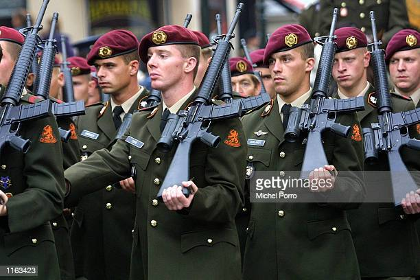 Dutch army officers march amid incresing security during the parade of Dutch Queen Beatrix on her way to present the cabinet with the budget for 2002...