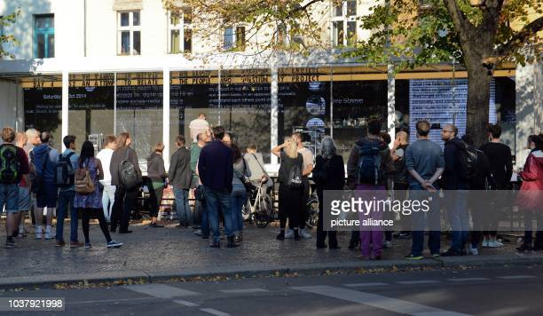 Dutch artist Dries Verhoeven sits in a glass container on Heinrichplatz inBerlinGermany 04 October 2014 He chats with passersby on the dating app...