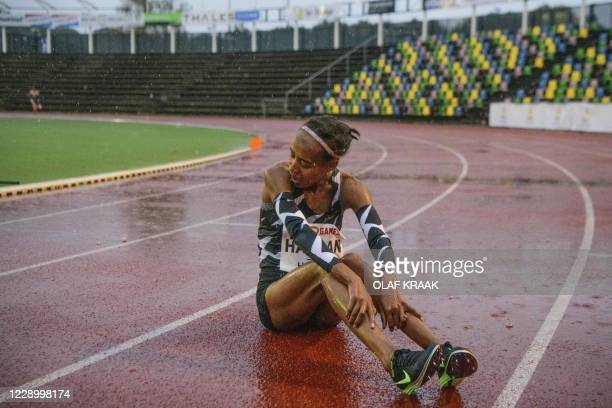 Dutch athlete Sifan Hassan sits on the track after her 10 kilometres run at the FBK Late Summer race in Hengelo, on October 10 after breaking the...
