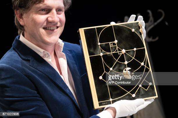 Dutch author Mark Zegeling shows a special edition of the book 'The Secret of the Master' made of 18k gold and covered with pearls for a value of...
