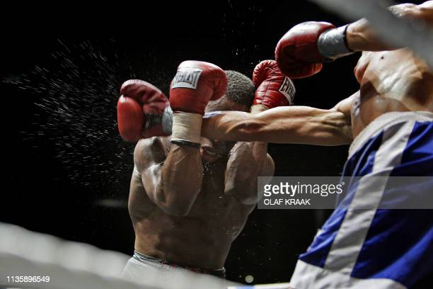 Dutch boxer Innocent Anyanwo in action during his fight against French Mihad Boukedim at a boxinggala in honour of late Dutch boxer Ben Bril in...