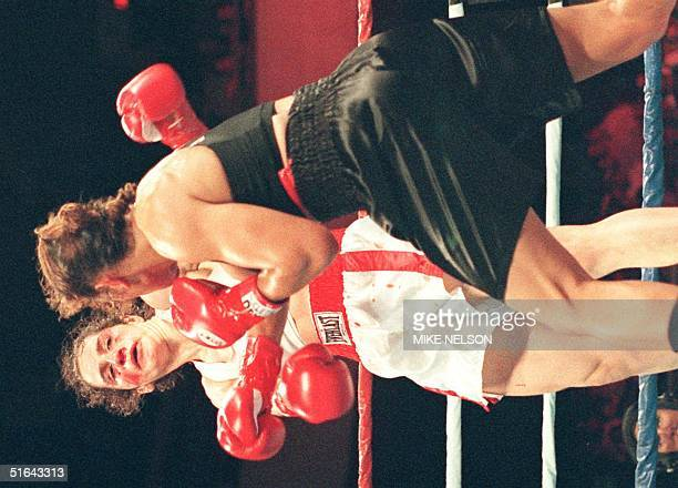 Dutch boxer Lucia Rijker lands a right to knock out German boxer Jeanette Witte in the third round of the Women's International Boxing Federation...