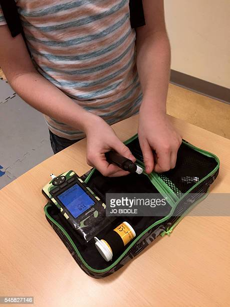 Dutch boy Ruben van As who has childhood diabetes shows off his lifesaving kit which he carries with him all the time and can show him immediately...
