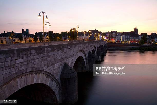 Dutch canal and bridge at sunset