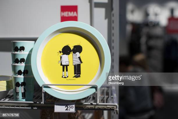 Dutch cartoon characters Jip and Janneke adorn drinking cups and plates inside a Hema BV store in Tilburg Netherlands on Wednesday Oct 4 2017...