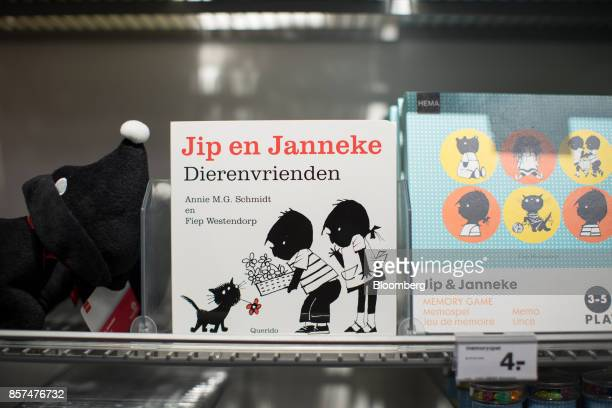 Dutch cartoon characters Jip and Janneke sit on children's books and games inside a Hema BV store in Tilburg Netherlands on Wednesday Oct 4 2017...